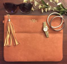 Monogrammed Uptown Tassel Clutch - perfect for traveling in style! Available in 9 colors for just $39.99!