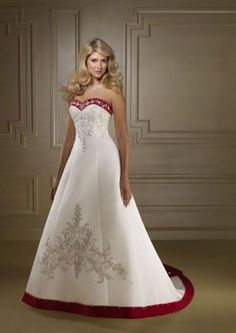 strapless white wedding dress with red trim.