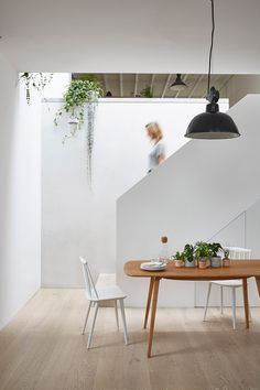 """leibal: """"Hackney Mews House is a minimal home located in London, United Kingdom, designed by Hutch. A complete reconfiguration and extension of a Mews House in Hackney, for a young, growing family. New Staircase, Modern Staircase, Mews House, Folding Walls, Minimal Home, London House, Dining Room Design, Dining Area, Home And Deco"""