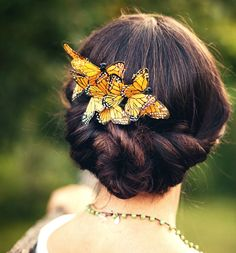 Let whimsy take flight on your big day with bright Monarch butterfly clips.