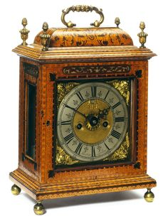 Bracket Clock - John Martin About 1695. Marquetry of sycamore, with walnut, holly, boxwood and purpleheart, some stained by scorching, with gilt-bronze mounts Museum no. W.61:1, 2-1926