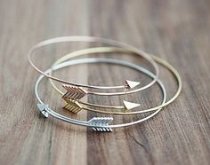 Follow your arrow wherever it points! Delicate and simple, this bracelet looks great stacked or on its own. http://amzn.to/2svAfhR