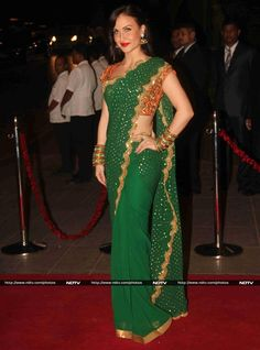 EuroIndo 'Bollywood' Actor Elli Avram as colorful as India in green, gold & orange @SeemaKKhan  https://www.facebook.com/seemakhanbandra190 #Saree at #ArpitaKhanReception, Nov, 14