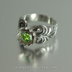 GREEN LOTUS silver ring with Peridot by WingedLion on Etsy https://www.etsy.com/listing/130543178/green-lotus-silver-ring-with-peridot