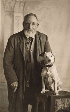 Lovely old man and his dog, vintage photo.