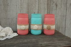 "3 quart size mason jars hand painted in coral and aqua with a ribbon of burlap and lace, and a burlap flower, lightly distressed with a protective coating. They are not painted on the inside and can hold water for fresh flowers. Clean with a damp cloth, not dishwasher safe. Perfect decor for beach decor, summer patio, wedding centerpiece etc... 7"" tall, 3.5"" in diameter Please email if you need different colors and amounts for your wedding, shower or other special event. All items ship…"