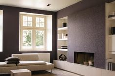 An abstract botanical design has been used to make a feature of the  #fireplace. #interiordesign