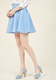 <p>If your moxie meter is showing low levels, this vintage-inspired mini skirt will boost your boldness back up! Brightened with white polka dots and tailored to create a twirl-worthy silhouette, this cornflower A-line - flared to perfection - is helpful in haute binds.</p>