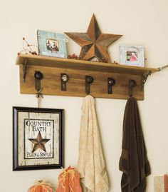 Give your bathroom rustic charm by crafting a shelf with barnwood, rusty brackets and old knobs.
