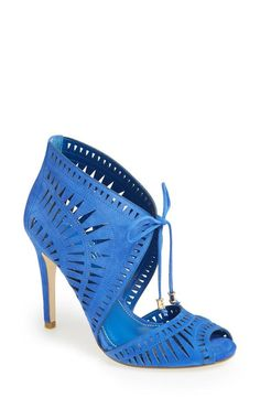 Nice! Love the cut-outs and laces on this bright blue sandal.