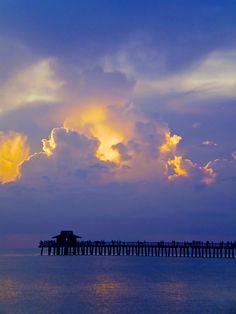 Sunset over pier.