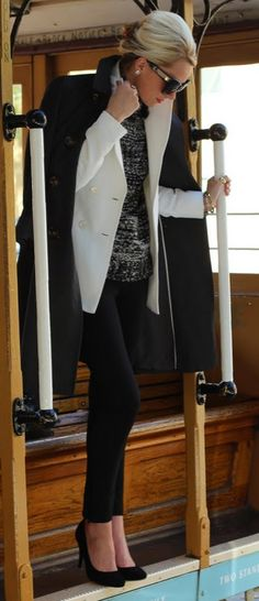 White suit jacket over black & white textured sweater  with black tight leggings & heels - novel, daring and classic. :)