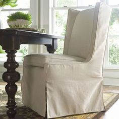 Pairing au courant style with coastal appeal, this chic design brings the allure of summer to your home d�cor.Product: Dining chair    Construction Material: Wood and fabric    Features:  Fitted slip cover    Wing back    Will enhance any dcor    Dimensions: 42 H x 25 W x 20 D