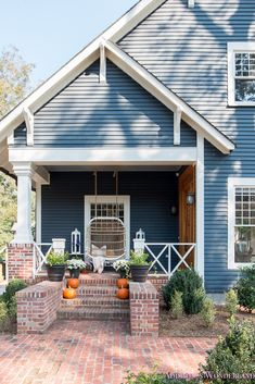 Fresh Ideas for Fall Home Tour! - Addison's Wonderland Inside our historic craftsman home restoration featuring white windows, dark blue gray exterior siding, rattan porch swing, large white lanterns and the cutest Fall pumpkins and decor! Craftsman Exterior, Exterior Front Doors, Modern Farmhouse Exterior, Craftsman Homes, Garage Doors, Exterior Paint Colors For House, Exterior Colors, Gray Exterior, Exterior Siding