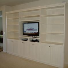 Custom entertainment center with wall unit storage by woodvisions, inc. Built In Tv Wall Unit, Tv Built In, Built Ins, Custom Entertainment Center, Entertainment Room, Wall Unit Designs, Off White Walls, Elderly Home, My Living Room