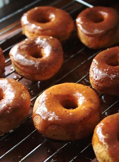 baked sweet potato doughnuts with a caramel cinnamon glaze- they're healthy, right? they're baked. :)