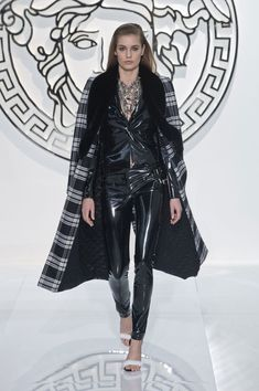 Versace Fall 2013 As you can see the plaid trend has really taken way and shown through in this jacket's textile. The heavy fur shawl collar and the warm inner lining makes for a perfect winter coat.