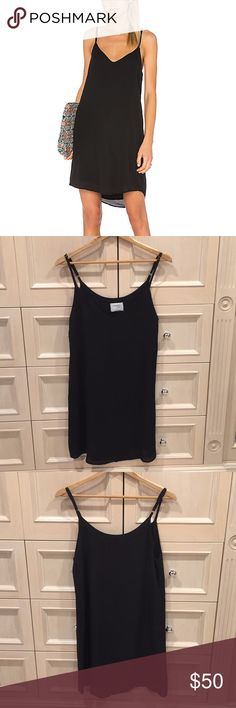 Sincerely Jules Black Capri Slip Dress Black mid-length dress with adjustable straps. V-shaped neck line. Designed by fashion blogger Sincerely Jules. This dress is easy breezy. Wear it alone or a white baby-t underneath. Sincerely Jules Dresses Midi