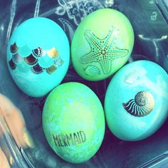 Mermaid inspired Easter eggs. After you have dyed your egg, rub temporary tattoos unto your dry dyed egg. #finfun #mermaids
