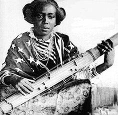 Vintage photo of a Malagasy woman playing the traditional Valiha - Madagascar