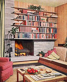 I'm loving this Mid-Century Modern fireplace/bookcase from VintageGoodness --the wood paneling, not so much, but cozying around this off-cen...