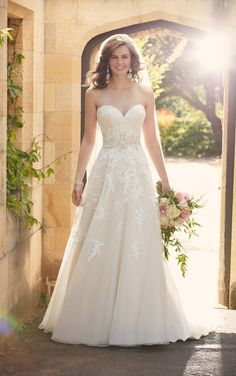 This Essense of Australia tulle A-line wedding dress features beaded lace throughout. The sweetheart bodice frames the face and waist slims the body.