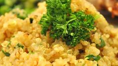 Quinoa is tossed with onion, garlic, and herbs. This may be served hot or at room temperature. It can also be cooked in chicken broth for added richness.