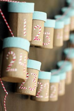 Cute advent calendar. The little tubes are large enough to hold a small candy and/or a rolled up piece of paper with either a scripture reading or seasonal activity prompt.