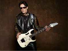 Evo is the name Steve Vai gave to his primary stage and recording guitar, an Ibanez It was designed by Vai and Ibanez back in Steve Vai, Hard Rock, Heavy Metal, Billboard Live, Famous Guitars, Strange Music, City Events, Les Paul Standard, Gibson Guitars