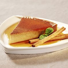 Cinnamon Flan this is similar to the delicious flan recipe a friend gave me: 4 large eggs, 1 can condensed milk, 1 can evaporated milk, 1 can milk, 1 tbsp vanilla, 1 tbsp rum extract, 1/2 tsp salt - mix all until we'll blended. 3 tbsp sugar - heat to caramel color; cover dish you put mixture on, sprinkle cinnamon, cook in water bath for 1 1/2 hour until toothpick comes out clean