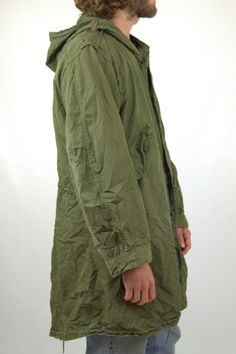 Vintage Korean War M51 Fishtail Parka M-1951 Korean War Era US Army Mod parka This jacket is in good vintage condition. Only issue to note is on of the snap closures has come away from the fabric. There is not a hole left though. The right sleeve cuff is missing button as well.  This is the ultimate Mod parka. Cult Classic.  Drawstring waist with leather toggles.  Measurements Shoulders: 22 Chest: 53 Sleeve: 24 Length: 37