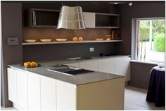 KitchenSynch presents:  This kitchen is from the SL101 range by SieMatic. The cabinets are finished in Greige Matt and Titan Walnut laminates and the worktop is 1cm reinforced Hintertiessen granite.