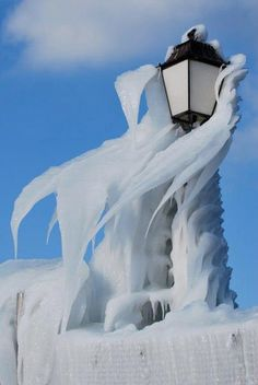 ❄️ Winter blue is magic❄️ / Lake Geneva lamppost after a major ice storm…