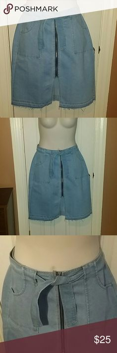 "Ashley Stewart Denim Skirt Gorgeous brand new light blue belted, 2 pocket, zip up denim skirt...has frayed edges and a small split in the front..skirt is pinned up in the back to keep up on ""average sized"" mannequin... Ashley Stewart  Skirts Midi"
