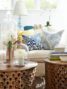 Patterned pillows in sunny yellow, royal blue and soft blue-gray add warmth. A mix of rustic textures, such as unfinished woods, wicker, and wrought iron, add visual weight to the light, bright spaces. In the living room, a pair of timeworn wooden tables work together to function as a central coffee table. This  is my bedroom colors and theme...