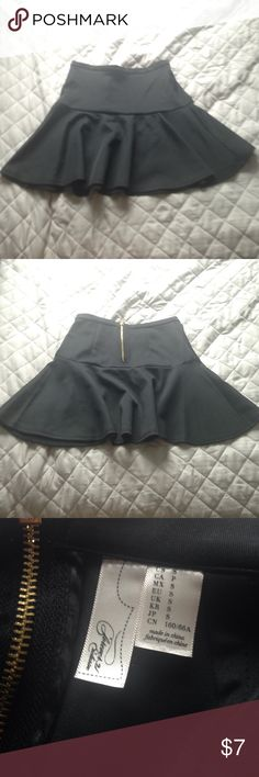 NWOT black mini skirt Took the tag off, but never worn.  Has a zipper at the back. 95% polyester, 5% spandex Forever 21 Skirts Mini