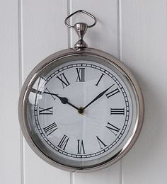 Close view of the chrome wall clock