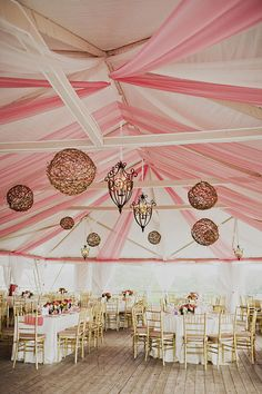 Pink and White Tent Reception With Chandeliers | photography by http://www.sloanphotographers.com/