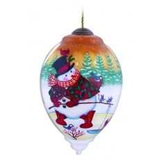 "Ne'Qwa ""Fishin' Friends"" Hand-Painted Blown Glass Christmas Ornament #7131161 Hand-made glass ornament depicts a snowman fishing with a beautiful sunset sky in the background. Also features the artist's signature and an antiqued gold topper and green tassel  Artist - Joseph Holodook"