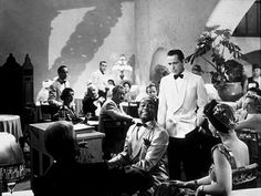 Casablanca (1942) photo from the film of Dooley Wilson as Sam and Humphrey Bogart as Rick Blain in the scene where Rick is not happy with the song Sam is playing (As Time Goes By).