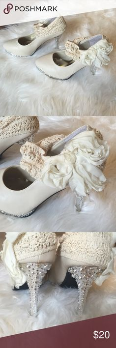 Size 6 heels Absolutely gorgeous size 6 heels. Never been worn! Silver studded bottom and flower on outer sides. Perfect for wedding or special occasion! Shoes Heels