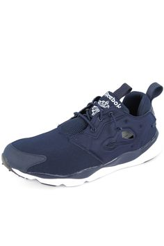 Reebok Furylite College Navy/Black/White  Descended from our iconic Pump Fury, this fashion-forward sneaker combines cutting edge looks with incredible comfort. Add it to your collection if you're a sneakerhead who loves bold architectural elements and daily wearability.  - Article Code: V68765 - Synthetic mesh upper for a soft and breathable fit - Low-cut design for added mobility and freedom of motion - 3D Ultralite outsole for incredibly lightweight cushioning - Molded quarter panel for…