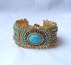 Tutorial Bead Embroidery Bracelet, Gold Turquoise Cuff Bracelet, Beading Pattern Bracelet, Greece Bracelet, PDF Instructions You can purchase the DIY Kit of my bead embroidered bracelet with the materials here: https://www.etsy.com/listing/290640855/free-shipping-bead-embroidery-kit?ref=shop_home_listings Unique beading pattern. Very detailed DIY tutorial for personal use only. Step by step PDF beading pattern for my Greece bead embroidered bracelet. Great for all levels, from beginner to…