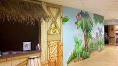 Worlds of Wow - Thatch roof check-in matches the themed jungle scene along the hallways at Church on the Rock!