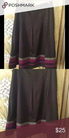 Brown A-line pleated skirt small New with tags size 4 Brown A line skirt has three pleats in front and back. Tan, pink and purple ribbons around hem. Excellent condition. Outer skirt 100% cotton, lining 100% cotton. Measures 27 inches from top to bottom East 5th Skirts Midi