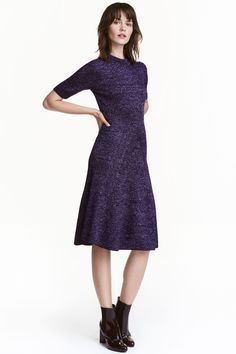 Ribbed dress: Short-sleeved, knee-length dress in a rib knit containing glittery threads. The dress is fitted at the top and flares to the hem. Unlined.