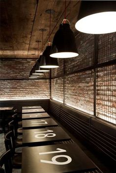 Black steel mesh on walls numbers on tables