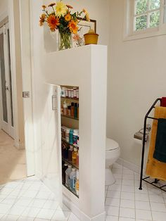 Storage Wall: A partial wall is a great way to create a private compartment for the toilet. Put the wall to work by finishing space between the framing with drywall and shelves. A door keeps everything under wraps.
