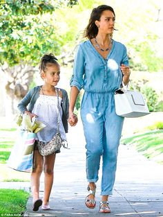Jessica Alba wearing Delman Maud Flat Sandals in Silver Sam & Lavi Ryleigh jumpsuit Capwell + Co Lucite and Metal Triangle necklace