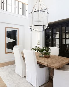 36 Chic Dining Room Design Ideas That Looks So Cute Minimalism Living, Rooms Ideas, Reclaimed Wood Dining Table, Wood Dining Tables, Dining Table Lighting, Coffee Tables, Slipcovers For Chairs, Fabric Chairs, Dining Room Inspiration